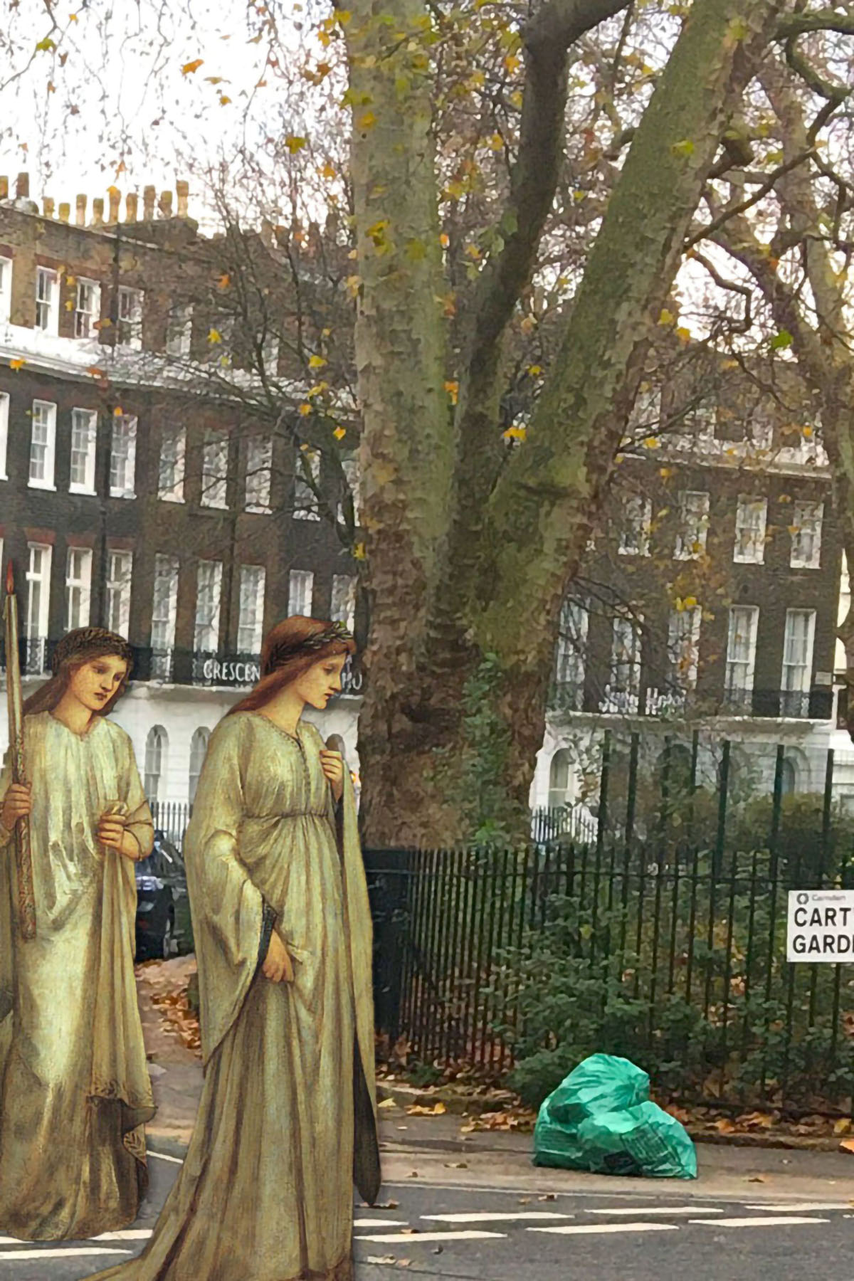 "Figures from Edward Burne-Jones's ""Princess Sabra Led to the Dragon"" (1866) near Cartwright Gardens, Bloomsbury, London"
