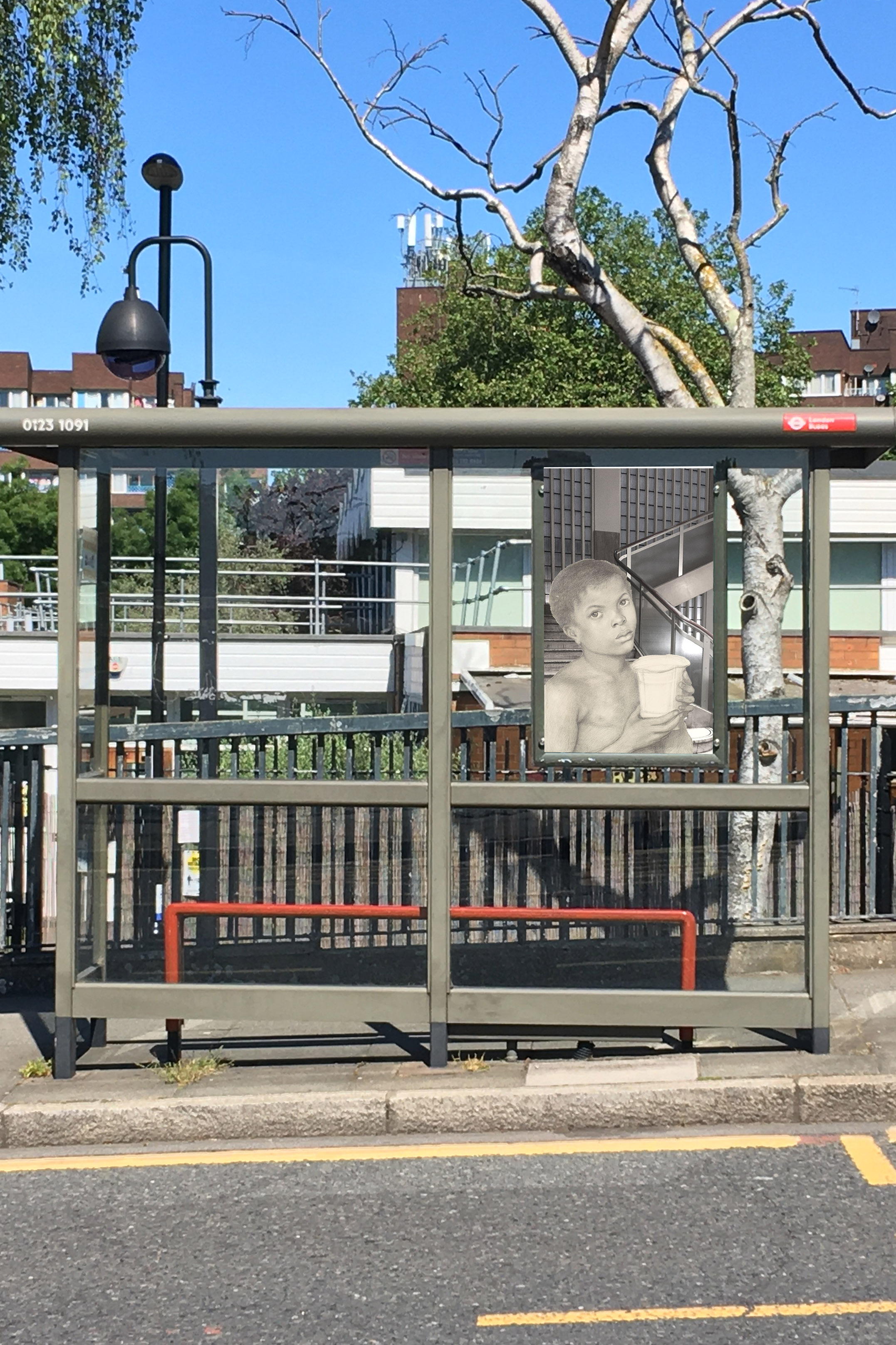 """Dante Gabriel Rossetti's """"The Beloved – Study of a Black Boy"""" (1865–66) in front of the stairway in the Piccadilly Waterstones (b&w) on the side of a bus stop on Oxestalls Road next to Deptford Park School, Deptford, London"""